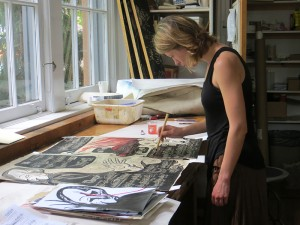 Anna Pidgorna working on a piece of art, to accompany a score. Photo by M. Teresa Simao.