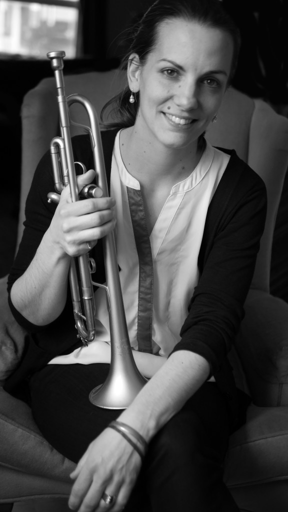 Rebecca Hennessy Black and White Headshot with trumpet